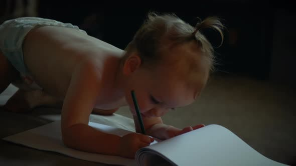 Baby Drawing In Living Room Wearing Diaper
