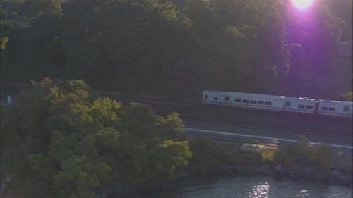 Aerial Drone Shot Tracking Train Leaving New York City Along Hudson River