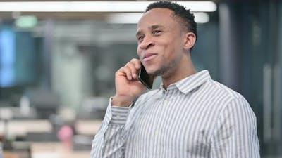 African Businessman Talking on Smartphone