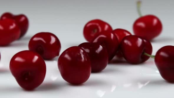 Thumbnail for Red cherries falling onto a table