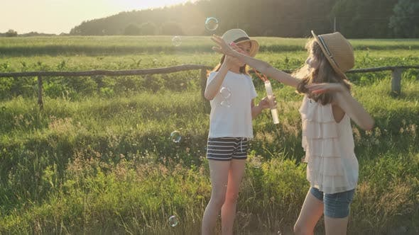 Thumbnail for Children Blowing Soap Bubbles, Two Girls Playing in Nature