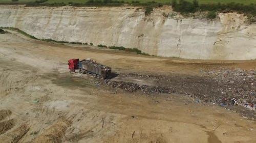 A Landfill Lorry is Unloading Garbage Into Junkyard