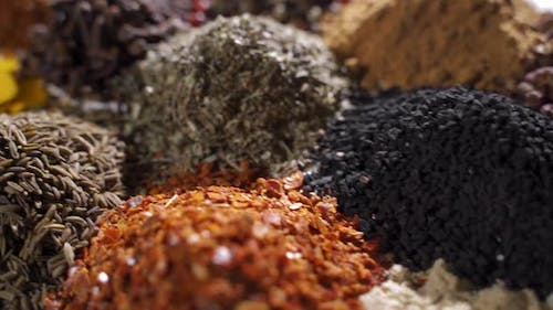 Different Spices and Aromatic Herbs Laid Out on a White Background