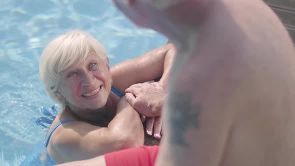 Thumbnail for Happy Mature Couple Relaxing at the Pool in Hotel Complex Together