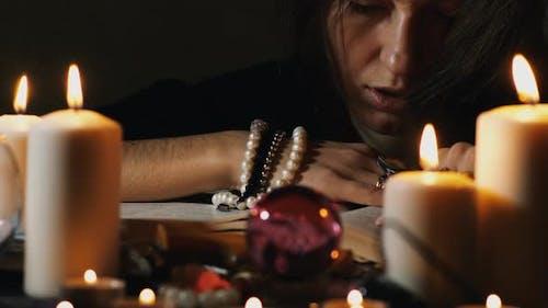 Magician read ancient book.