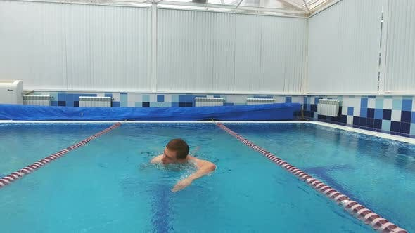 Thumbnail for Young Man Swimming the Front Crawl in a Pool