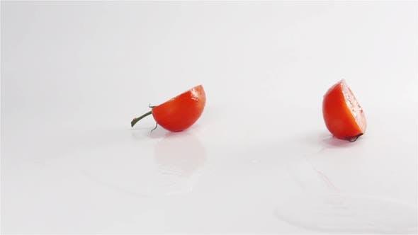 Thumbnail for Two Halves of Tomato Breaks Hitting White Surface