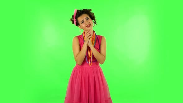 Thumbnail for Lovely Girl Looks with Tenderness with Folded Arms in Front of Her. Green Screen