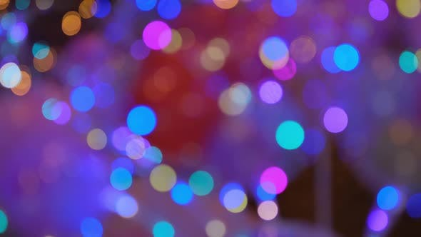 Shimmering abstract colored circles defocused christmas lights video. Blurred fairy lights.