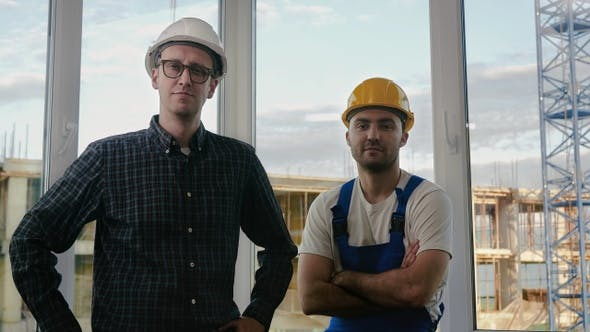 Thumbnail for Builders working team looking to camera at construction site.