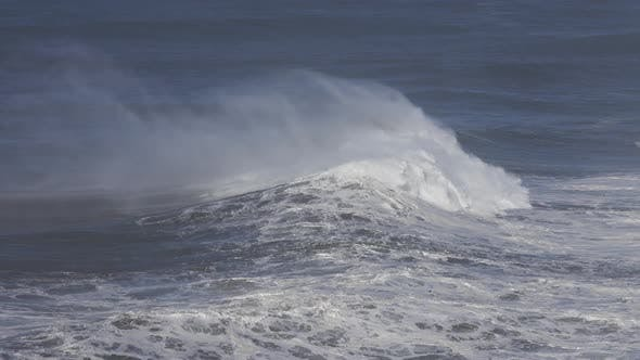 Large Wave Rolling on Surface of Stormy Ocean