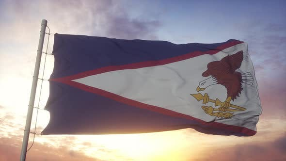 Flag of American Samoa Waving in the Wind Sky and Sun Background