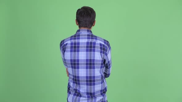 Cover Image for Rear View of Young Hipster Man Thinking and Waiting
