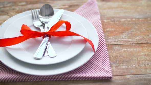 Thumbnail for Cutlery Tied with Red Ribbon on Plate