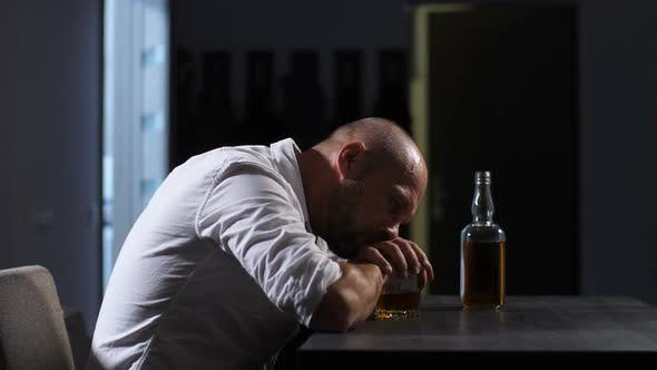 Cover Image for Lonely Depressed Adult Man Drinking Whisky at Home