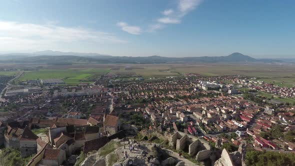 Aerial shot of Rasnov town and fortress