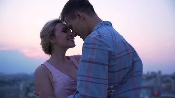 Thumbnail for Couple in Love Dancing Slowly on Roof of House Enjoying Freedom and Kissing