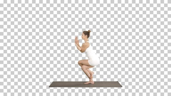 Cover Image for Beautiful young woman doing yoga exercise for ankles calves,