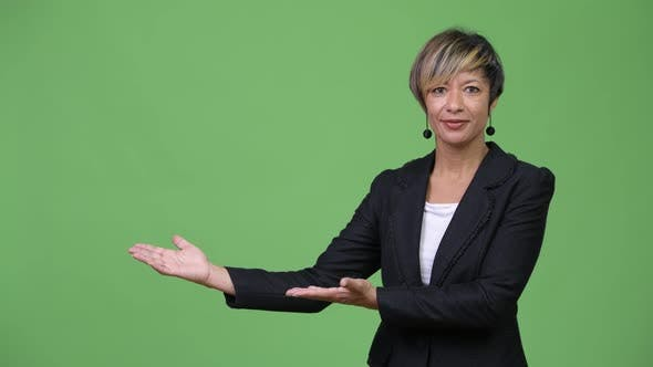 Thumbnail for Mature Beautiful Multi-ethnic Businesswoman Showing Something
