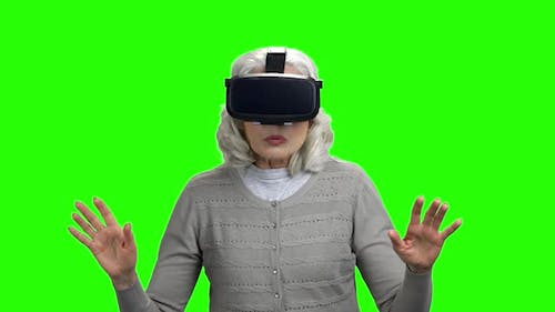 Old Woman Wearing Virtual Reality Glasses