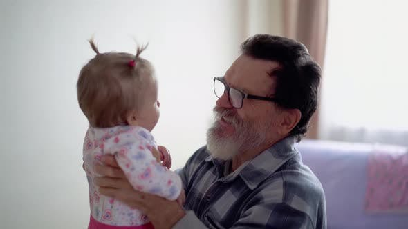 Thumbnail for Grandfather with a Beard, Wearing Glasses, Playing