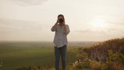 Girls Starts to Take Photos of a Beautiful Landscape