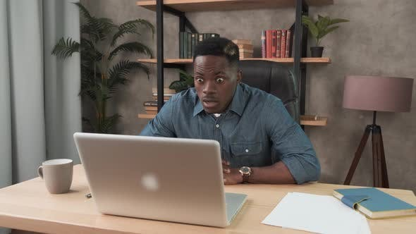 Thumbnail for Funny African Business Man Feeling Happy of Work Results. Excited Black Man Getting Good Project