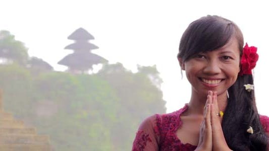 Girl Saluting With Both Hands In Bali