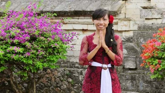 Girl Saluting With Both Hands In Bali 1