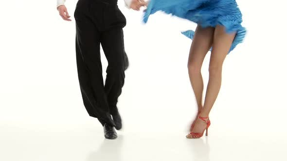Thumbnail for Legs of Pair Professional Ballroom Dancers Perform Rumba, White Background
