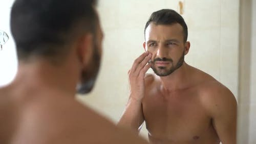Man Worried About Dark Circles Under Eyes and Unhealthy Complexion After Party