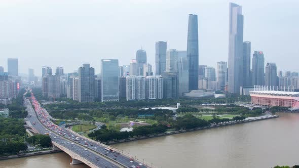Thumbnail for Guangzhou Cityscape China with Boats Traffic and Bridges
