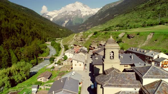 Aerial view of Lanslebourg village and snow peak mountain, Savoie, France. - product preview 0
