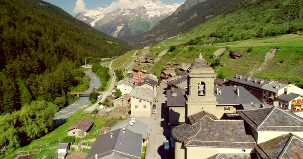 Aerial view of Lanslebourg village and snow peak mountain, Savoie, France.