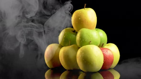 Thumbnail for Smoke Covering Pile of Juicy Apples with Water Droplets on Them