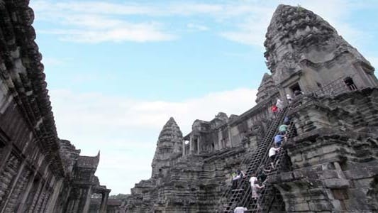 Thumbnail for Tourists Climbing Angkor Wat1