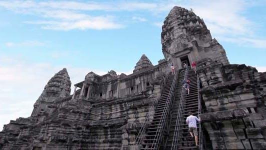 Thumbnail for Tourists Climbing Angkor Wat