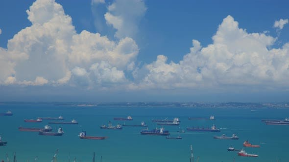 Thumbnail for Time Lapse shot of hundreds of cargo ships anchored off the coast of Singapore