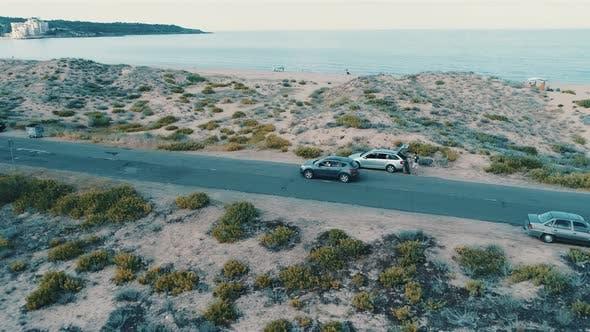 Thumbnail for Car Driving at Asphalt Coast Road. Sand Beach and Clear Blue Sea Water