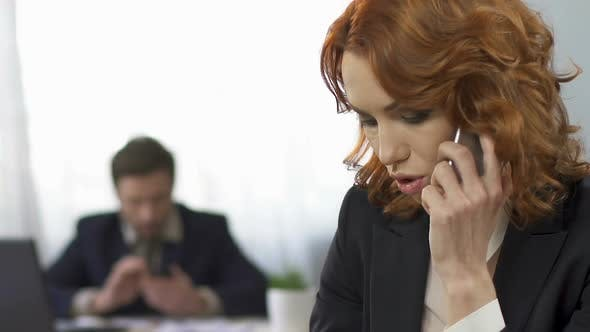 Thumbnail for Sad Businesswoman Talking on The Smartphone at Workplace, Stress, Overworking