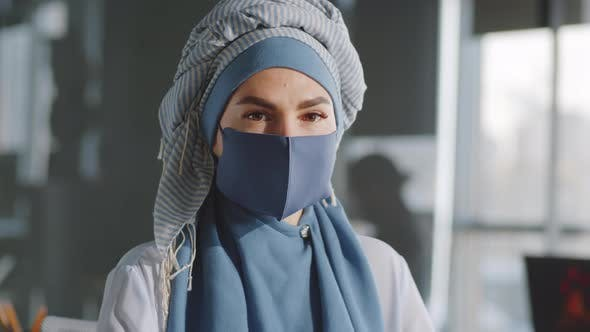Portrait of Muslim Businesswoman in Hijab and Mask