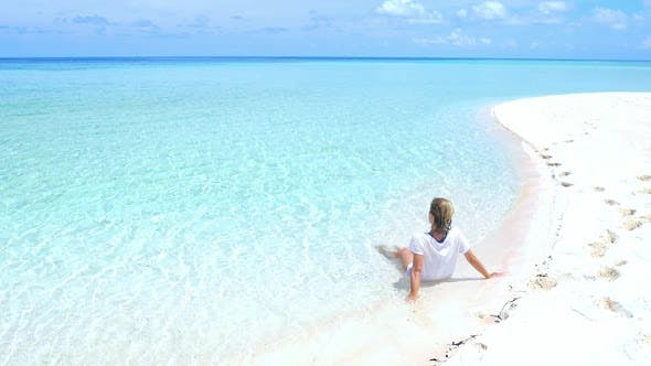 Thumbnail for Slow motion: woman sunbathing relaxing in turquoise water white sand beach tropical sea Indonesia