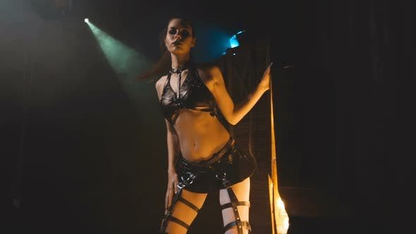 Thumbnail for Beautiful Woman in Black Lingerie and Leather Belt Dominates