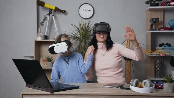 Thumbnail for Woman Playing Video Games with Her Teen Smiling Son Using Protective Virtual 3d Glasses