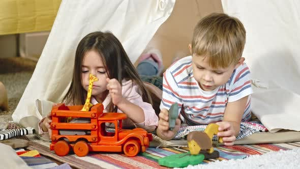 Cover Image for Little Girl and Boy Playing with Toys