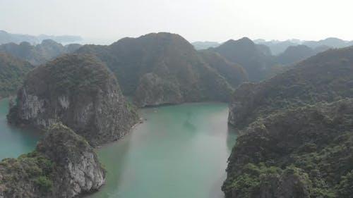 Aerial: unique flying over Ha Long Bay, famous tourism destination in Vietnam