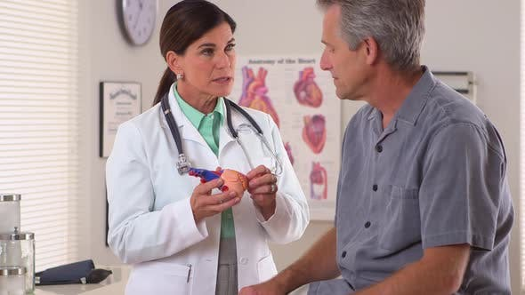Thumbnail for Woman doctor explaining patient's heart problem