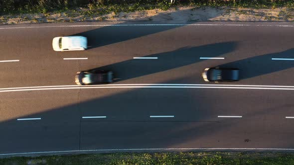Thumbnail for Static shot from aerial top view of passing cars on highway road