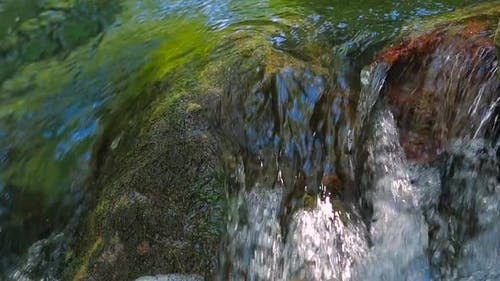 Small Waterfall with Rocks in the Water