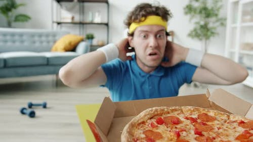 Slow Motion of Bizarre Sportsman Doing Crunches and Stretching Arms to Pizza Exercising Alone in
